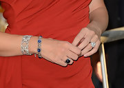 Delicate diamond bracelets added a touch of refined to Jennifer's romantic red dress.