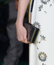 Michelle Williams' black hard case clutch was the finishing touch to her red carpet look at the premiere of 'Oz.'