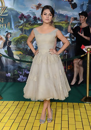 Mila departed from her usual fitted dresses at the 'Oz' premiere, choosing instead to wear this darling lace fit-and-flare number.