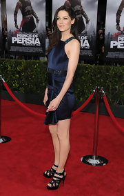 Michelle completed her midnight blue frock with a pair of strappy black patent leather sandals.
