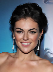 Serinda Swan paired her voluminous updo with dangling crystal earrings.