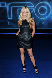 Charlotte dons a leather cocktail dress with deep pockets for the 'Tron: Legacy' premiere.