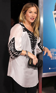 Actress Christina Applegate attended the premiere of 'Hall Pass' wearing a pavé and pearled bangle paired with a black pavé pearl hinge bangle.
