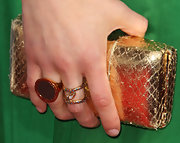 Alexandra wore golden cocktail rings with elegant gemstones at the premiere of 'Hall Pass.'