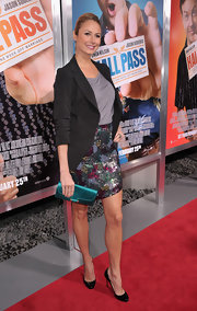 Stacey Keibler played up her floral print skirt with a satin turquoise clutch.