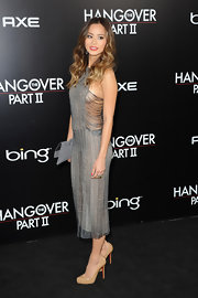 Jamie Chung teamed her racy knit dress with nude patent pumps.
