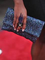 Naturi paired her sparkling clutch with a feathered cocktail ring.