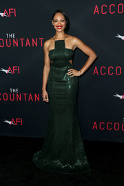 Cynthia Addai-Robinson made a head-turning entrance in an emerald-green Jay Godfrey sequin gown, featuring side cutouts and a halter neckline, at the premiere of 'The Accountant.'