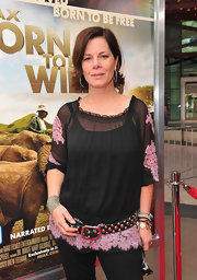 Marcia Gay Harden wore a metal studded leather belt on top of her loose top at the premiere of 'Born To Be Wild 3-D.'