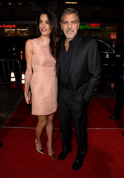 Amal Clooney attended the premiere of 'Our Brand is Crisis' wearing a simple yet sweet pink mini dress by Roland Mouret.