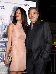 Amal Clooney accessorized with an elegant snakeskin and metal box clutch by Ferragamo when she attended the premiere of 'Our Brand is Crisis.'