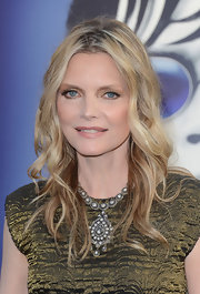 Michelle Pfeiffer attended the 'Dark Shadows' premiere wearing her long layered locks in tousled waves.
