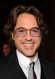 There isn't a style that Robert Downey Jr. can't pull off.  Wearing his hair a bit longer than usual, Robert perfects the long loose waves.