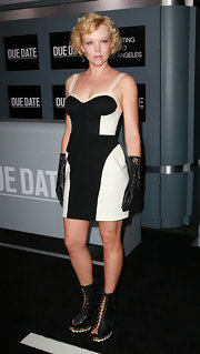 Emily Bergl sported dramatic lace up boots with ridged soles. The actress even matched the funky footwear to a pair of leather gloves.