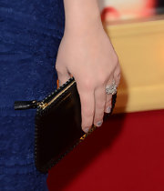 Melissa Joan Hard added a touch of edge to her blue cocktail dress with this black leather, zip-up clutch.