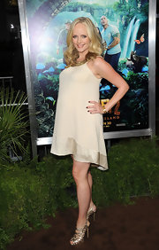 Marley topped off her maternity dress with gold strappy sandals.