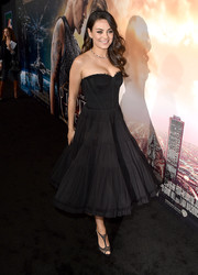 Mila Kunis cut a charming figure in a strapless black corset dress by Dolce & Gabbana during the premiere of 'Jupiter Ascending.'