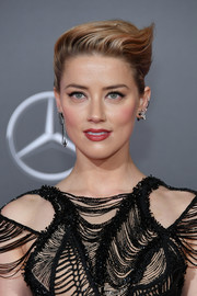 Amber Heard rocked a sculpted French twist at the premiere of 'Justice League.'
