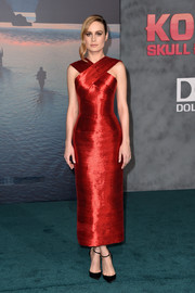 Brie Larson was a vision in a shimmering red Oscar de la Renta dress with a crossover neckline at the premiere of 'Kong: Skull Island.'