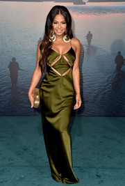 Christina Milian got majorly sultry in a forest-green Massachi slip dress with a peekaboo bodice at the premiere of 'Kong: Skull Island.'