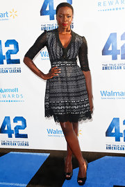 Danai Gurira chose a feminine lace frock with gray and white features for her red carpet look at the premiere of '42.'