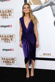 Amber Heard brought major allure to the premiere of 'Magic Mike XXL' with this ruched, deep-V purple dress by Monique Lhuillier.