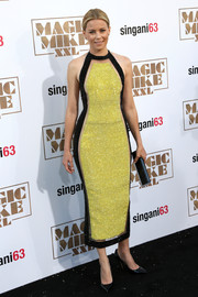 Elizabeth Banks sent temperatures soaring at the 'Magic Mike XXL' premiere with this majorly sultry Balmain halter dress in yellow and black with sheer inserts.