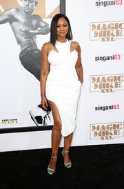 Garcelle Beauvais teamed her sultry dress with bright green slim-strap sandals.