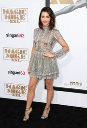 Jenna Dewan-Tatum kept the shine coming with a pair of silver strappy sandals by Jimmy Choo.