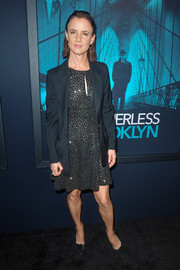 Juliette Lewis topped off her dress with a black blazer.