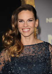Hilary Swank wore her long shiny tresses in a romantic, side-swept 'do at the premiere of 'New Year's Eve.'