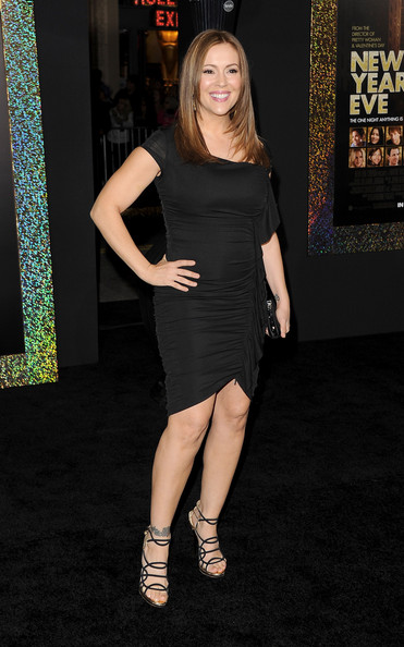 Alyssa Milano was chic in a LBD at the 'New Years Eve' premiere. She accessorized her look with strappy platform sandals.