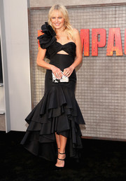 Malin Akerman went for festive glamour in a ruffled black one-shoulder gown by Johanna Ortiz at the premiere of 'Rampage.'