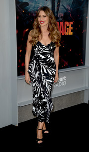 Sofia Vergara was tropical-glam in a curve-flaunting palm-print dress by Michael Kors at the premiere of 'Rampage.'