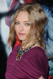 Amanda Seyfried toned down her look with lustrous nude lipstick. A slightly flushed cheek finished off her impeccable look.