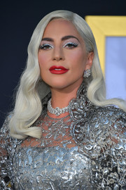 For added sparkle, Lady Gaga accessorized with a pair of diamond earrings by Bulgari.