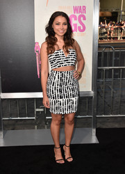 Jessica Parker Kennedy tied her look together with a pair of black slim-strap sandals.