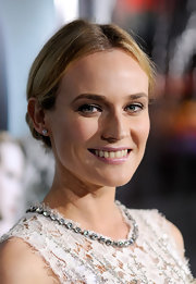 Diane Kruger wore simple diamond stud earrings to the premiere of 'Unknown'.