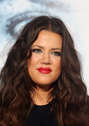 Khloe vamped up her perfectly lined eyes with classic red lips. We rarely see the reality star rock a look this bold, but we love it!