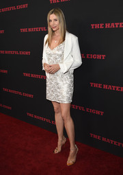 Mira Sorvino topped off her dress with a white cropped jacket.