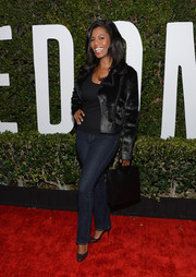 Omarosa Manigault glammed up her casual ensemble with a black fur jacket when she attended the 'Mandela: Long Walk to Freedom' Hollywood premiere.