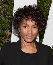 Angela Bassett wore her hair short with high-volume curls when she attended the 'Mandela: Long Walk to Freedom' Hollywood premiere.