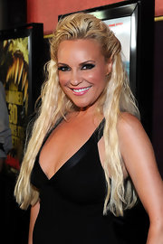 Bridget sported long mermaid waves in a loose half-up hairstyle.