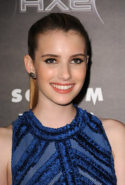 Emma Roberts paired her sleek ponytail with 18-karat polished black gold and diamond Panteao earrings.