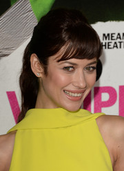 Olga Kurylenko went for a youthful vibe with a ponytail and girly bangs when she attended the 'Vampire Academy' premiere.
