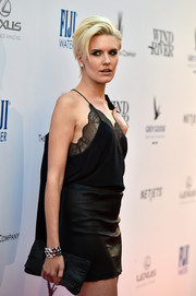 Maggie Grace arrived for the premiere of 'Wind River' carrying a black chainmail and leather clutch.