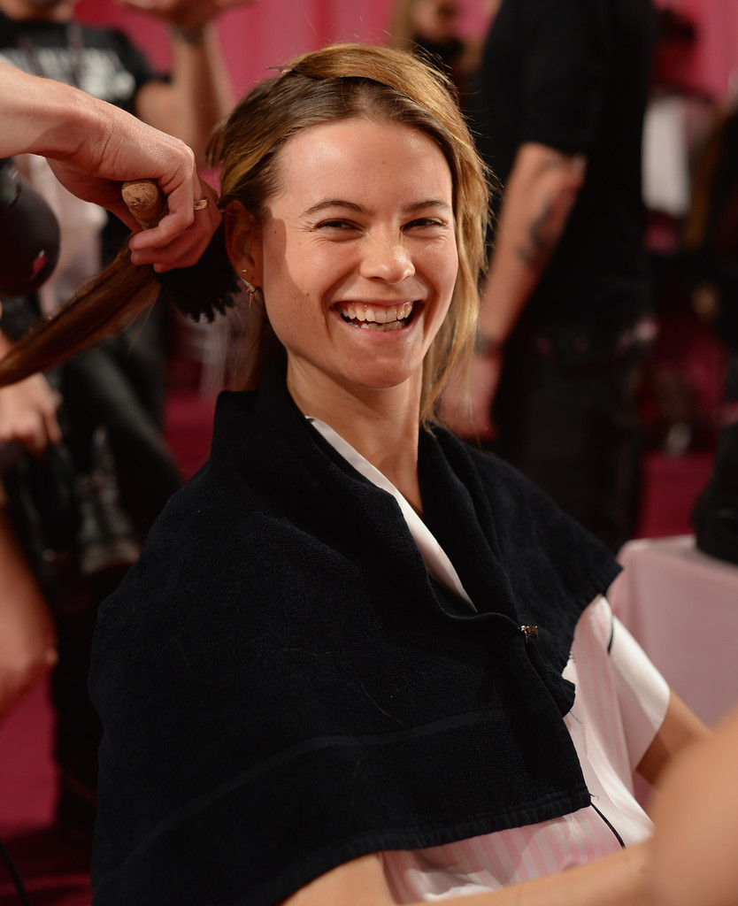 Model Behati Prinsloo prepares at the 2013 Victoria's Secret Fashion Show hair and make-up room at Lexington Avenue Armory on November 13, 2013 in New York City.