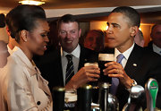Michelle Obama was glamorously coiffed in a French twist while enjoying a glass of Guinness in Ireland.