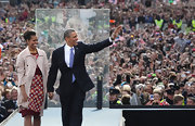 Michelle Obama layered a beige trenchcoat over her print dress for a classic finish during a trip to Ireland.