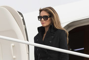 Melania Trump accessorized with a pair of square sunglasses by Gucci while attending a wreath-laying ceremony at Arlington National Cemetery.